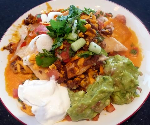 vegan nacho plate with soy cheese guacamole tofutti sour cream and black beans