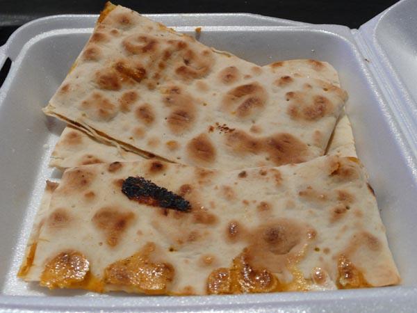 quesadilla: half mozzarella, half cheddar served in chapatti bread. $6