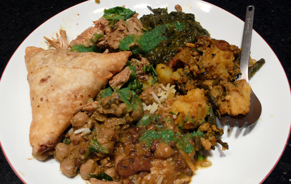 a samosa with potatoes, chickpeas, lentils, potatoes w/ long beans, bitter melon, spinach tofu and jackfruit.