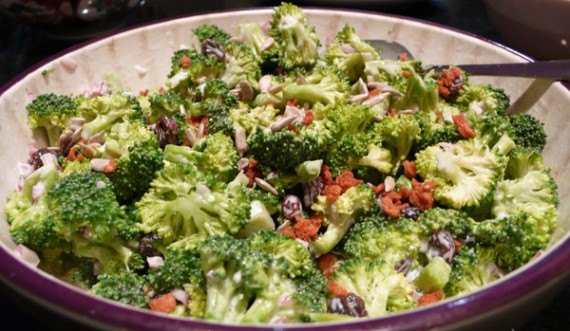 vegan broccoli salad with raisins, vegenaise, &quot;bacon&quot; bits and onion.