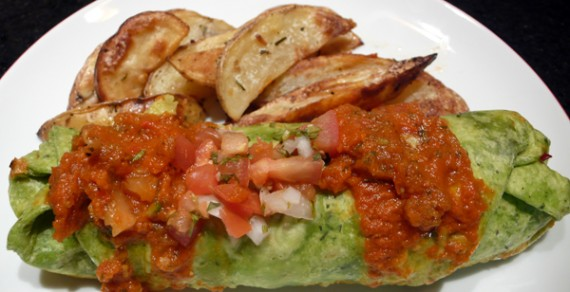 breakfast wrap: the whole enchilada's wrapped up for your morning meal. black beans, guacamole, spinach, mushrooms, garlic, cilantro and vegan tofu scramble in a whole wheat or spinach tortilla. served with ranchero sauce and pico de gallo. $10