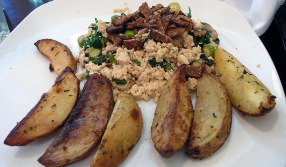 tofu scramble hash: we start with organic tofu and scramble it with asparagus, mushrooms, spinach, miso and nutritional yeast to end up with a nourishing and wholesome dish. comes with veggie bacon. $13