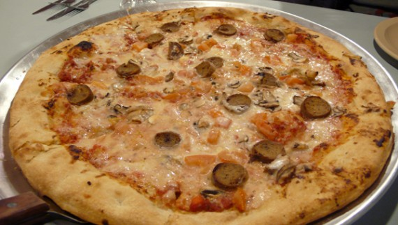 16 inch pizza with vegan cheese, tomatoes, mushrooms and tofurky sausage.