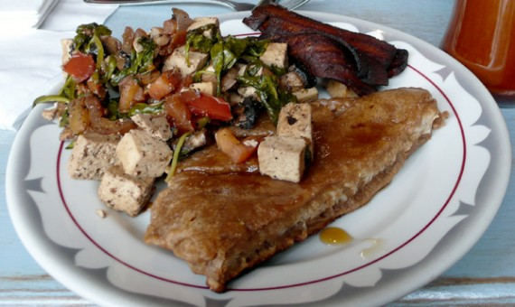 flore cafe all you can eat vegan brunch for $10. pictured is the french toast, tofu scramble and vegan bacon.
