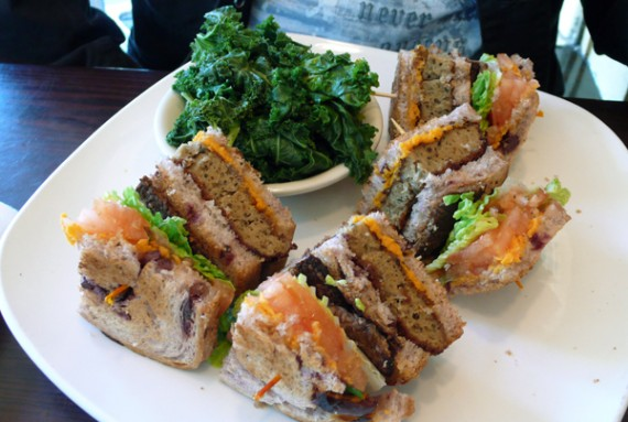 the california club: layered bread, breaded seitan with tempeh bacon, vegan cheddar, lettuce and tomato. $12