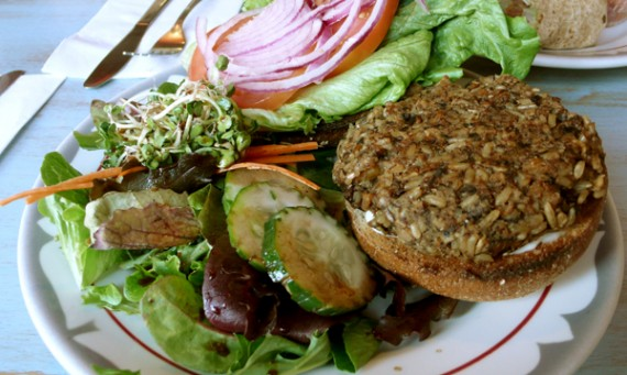 smokey seitan &amp; portobello burger: served with red onion, lettuce, tomato, vegenaise and side salad. $9.95