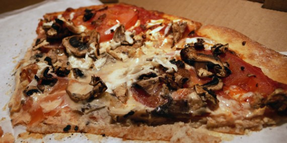 vegan pizza to go! teese, mushrooms, tomato and chopped garlic. YUM.
