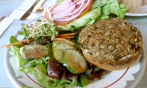 Smokey Seitan &amp; Portobello Burger: served with red onion, lettuce, tomato, vegenaise and a side salad. $9.95