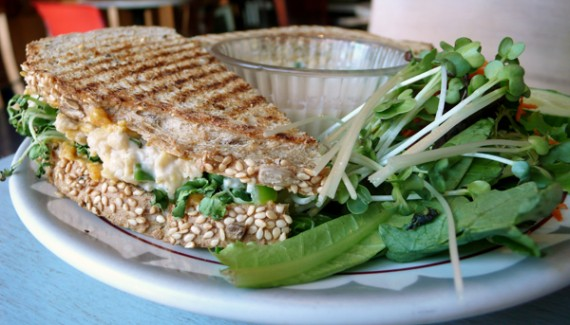Tempeh Tu-no Melt: Tempeh salad, daikon sprouts and cashew cheese layered on organic seeded six grain bread grilled to warm, soulful perfection. Served with a mixed green salad. $8.95