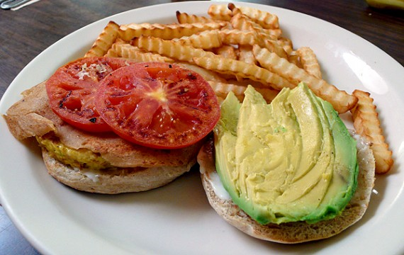Lorenzo's Tofu Eggwich: A Grilled Scrambled Tofu Pattie, Tomato and *Pastrami* Wheatmeat, with Avocado and Vegenaise on our Homemade English Muffin. Served with Fries or Fresh Fruit. $6.95