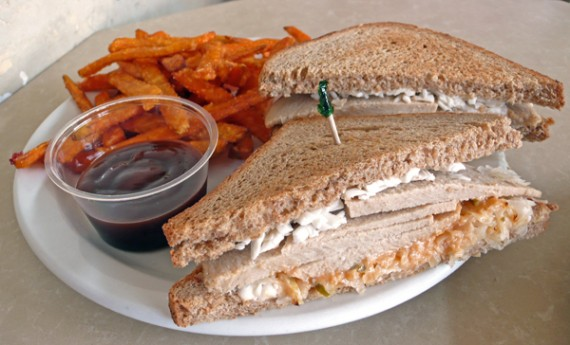 vegan reuben: veggie ham served warm with soy mozzarella, thousand island dressing, and sauerkraut. with your choice of side. $8.50
