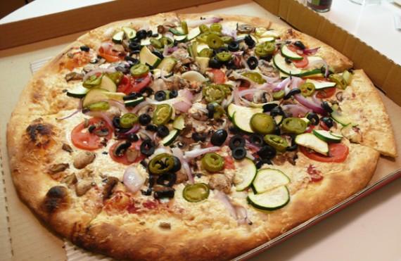 vegan california: organic tomato sauce, daiya cheese, fresh rounds of tomatoes, red onions, jalapenos, mushrooms, zucchini, black olives