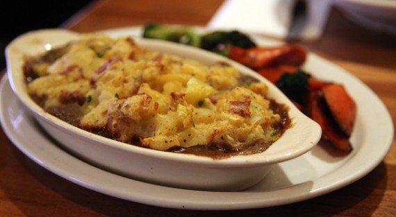 vegan root vegetable and beef shepard's pie with a sauteed broccoli and carrot side. $10.95