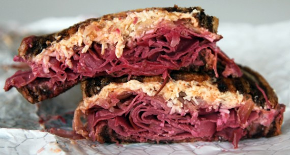 vegan reuben: marinated deli slices topped with daiya cheese, sauerkraut &amp; smothered with homemade vegan russian dressing. $9.75