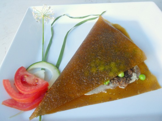 ... , anise walnut sausage, peas and greens in a coconut mango crepe